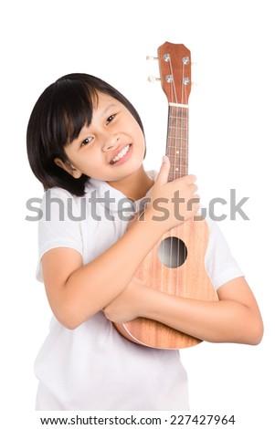 Young Asian girl holding Ukulele isolated on white background. - stock photo