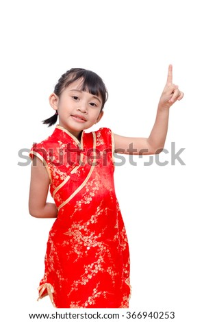 Young Asian girl in chinese traditional dress point to space above