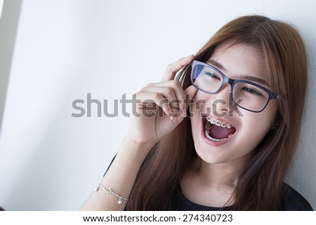 Young asian girl in smiling style with glasses and black shirt