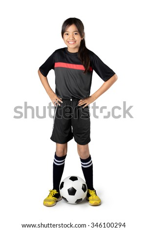 Young asian girl playing soccer, Isolated over white - stock photo