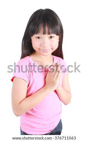 Young asian girl put her hands together and pray