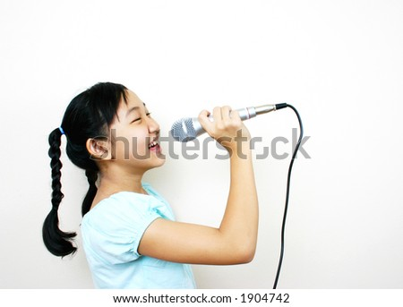Young asian girl singing. - stock photo
