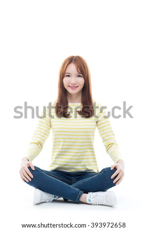 Young asian girl sitting on the floor isolated on white background.