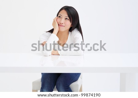 Young asian girl thinking - stock photo