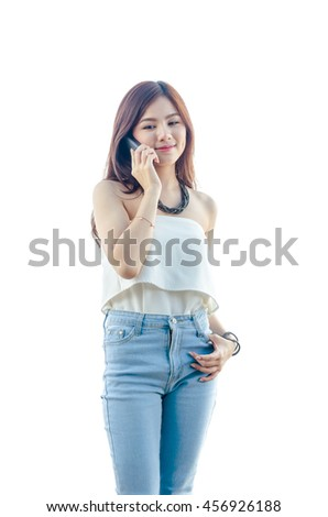 Young asian girl using cellphone over white background - stock photo