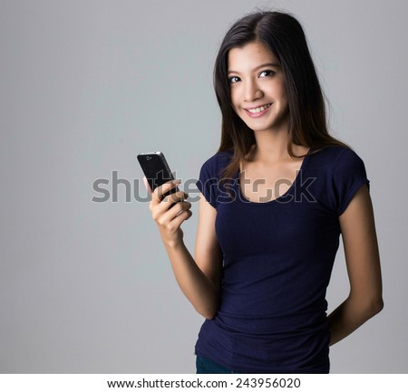 young asian girl using smart phone
