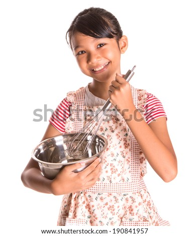 Young asian girl wearing kitchen apron and holding an egg beater and a steel bowl over white background