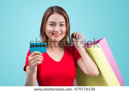 Young asian girl with credit card and shopping bags