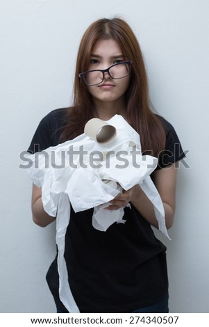 Young Asian girl with toilet paper in black shirt