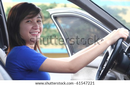 young asian happy lady driver - stock photo