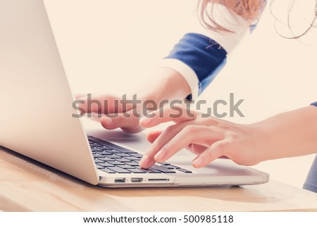 Young Asian happy woman with notebook laptop.