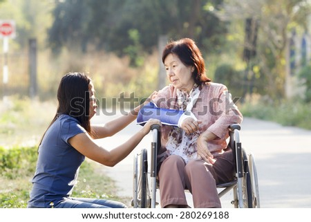 Young asian is taking care the senior woman ,Thailand - stock photo