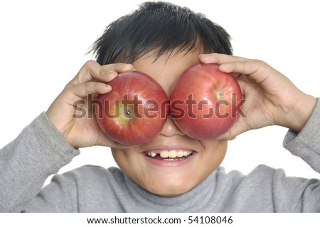 young asian little boy with apple - stock photo