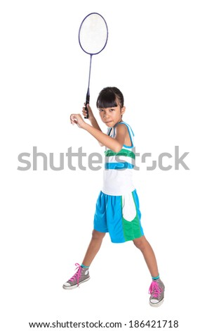 Young Asian Malay girl with a badminton racket over white background
