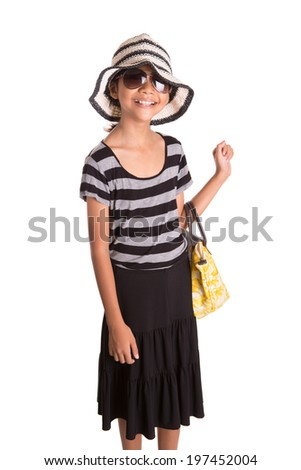 Young Asian Malay girl with sunglasses, hat, and a yellow handbag over white background