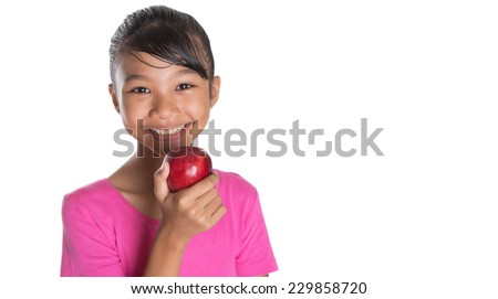 Young Asian Malay teenager with a red apple over white background - stock photo