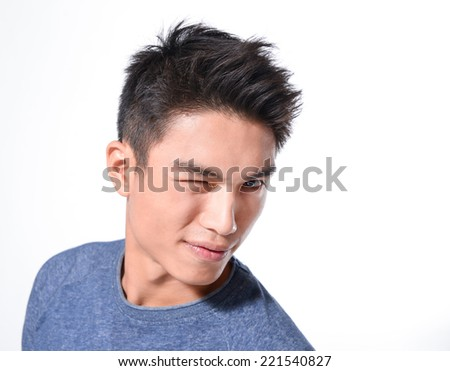 Young Asian man close up shot isolated