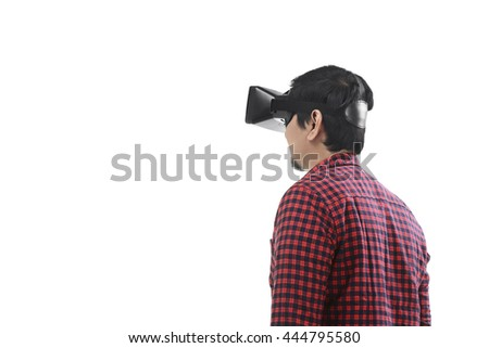 Young asian man experiencing virtual reality through a VR headset isolated on white background