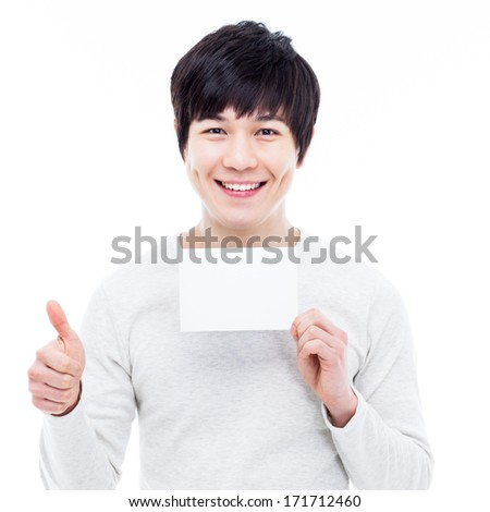 Young asian man showing empty card and showing thumb isolated on white background.
