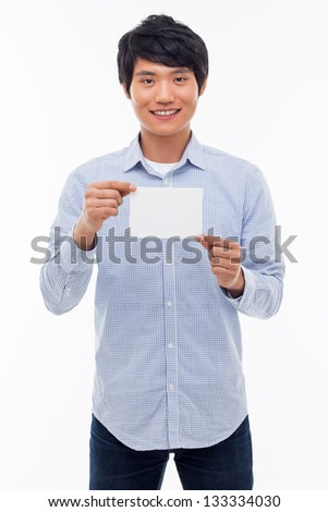 Young asian man showing empty card isolated on white background. - stock photo