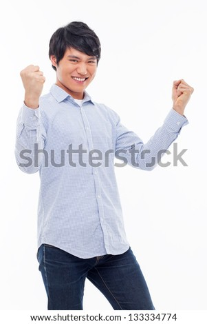 Young Asian man showing fist and happy sign isolated on white background. - stock photo