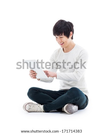 Young Asian man using a Pad PC isolated on white background.