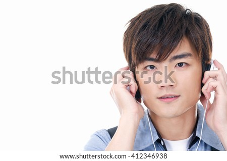 young asian man with headphones-white background - stock photo
