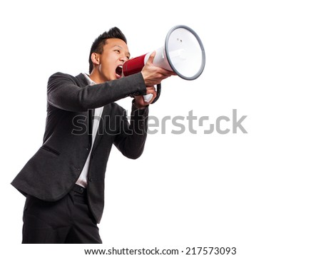 young asian man yelling with a megaphone