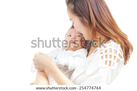 young asian mother and baby in the room - stock photo
