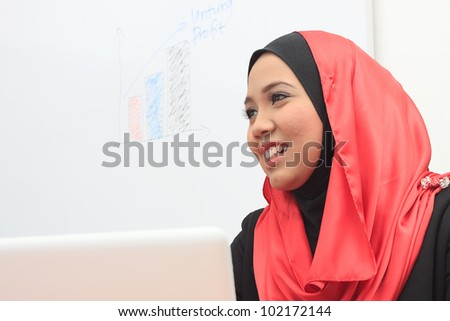 young asian muslim business women - stock photo