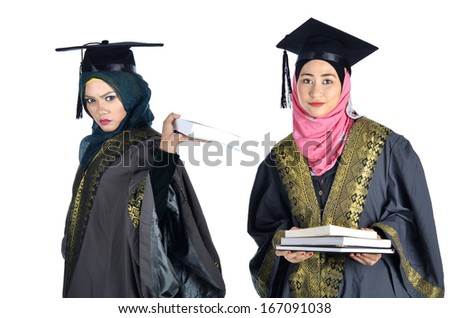 Young Asian Muslim graduate wearing graduation gown showing No to books