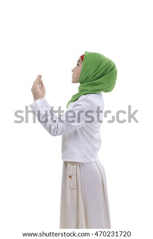 Young asian muslim man praying to god, she is pretty with isolated background