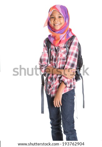 Young Asian Muslim school girl with head scarf carrying a backpack over white background - stock photo