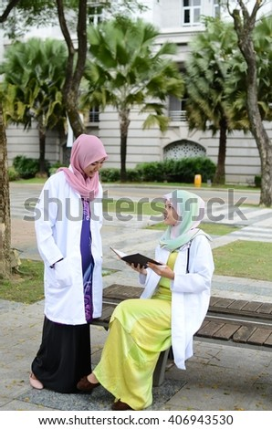 Young asian muslim woman in head scarf smile and happy meeting together