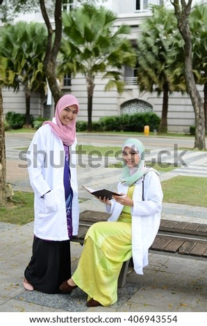 Young asian muslim woman in head scarf smile and happy meeting together - stock photo