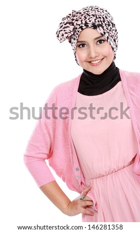 Young asian muslim woman in head scarf smile isolated over white background - stock photo