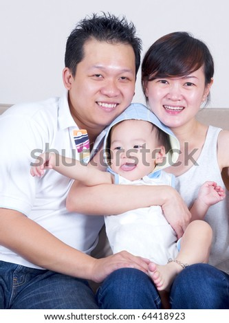 young asian parent and baby boy - stock photo