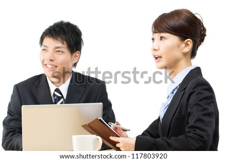 Young asian smiling businesswoman and businessman - stock photo