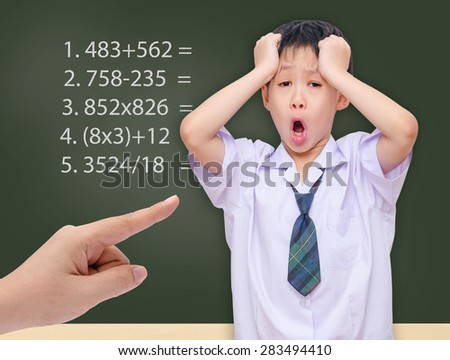 Young Asian student getting crazy with maths calculation studying - stock photo