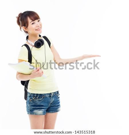 Young Asian student girl pointing side space isolated on white. - stock photo