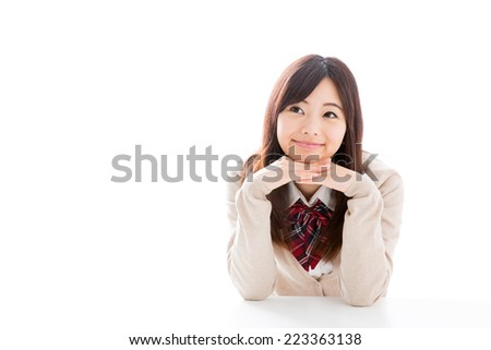 young asian student on white background - stock photo