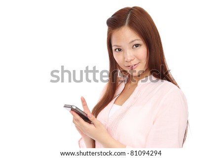 Young Asian teen using a smart phone