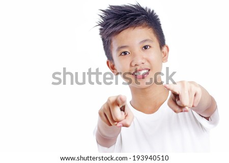 Young asian teenager pointing fingers to you.Isolated in white background. - stock photo