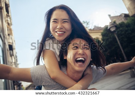 Young Asian Tourists Having Fun And Smiling