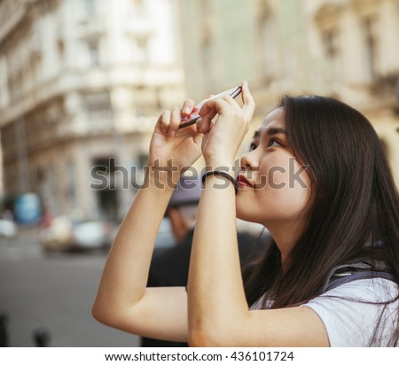 Young Asian Tourists Taking A Photo - stock photo