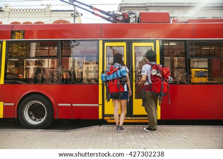 Young Asian Tourists Waiting For A Bus - stock photo