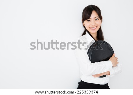 young asian waitress on white background - stock photo