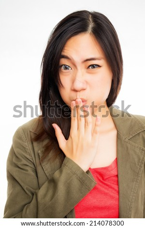 young asian woman annoyed by a bad smell that make her want to vomit - stock photo