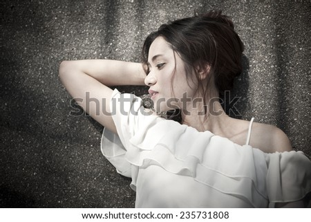 Young asian woman at outdoor  - stock photo