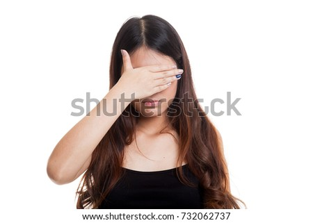 Young Asian woman close her eyes with hand isolated on white background